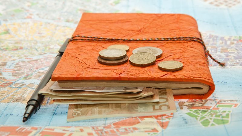 Close-up Travel Arrangement of Euro money, Map and notepad diary